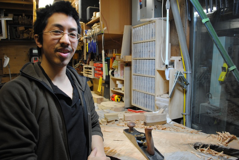 Chris Wong working in his shop