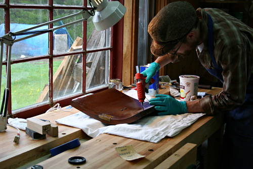 Joshua working at his workbench