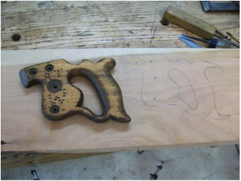 Tracing out the saw handle