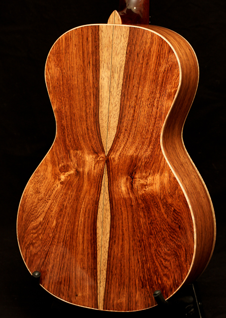 A bookmatched Honduran Mahogany guitar by Lichy Guitars