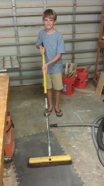Steven working the broom