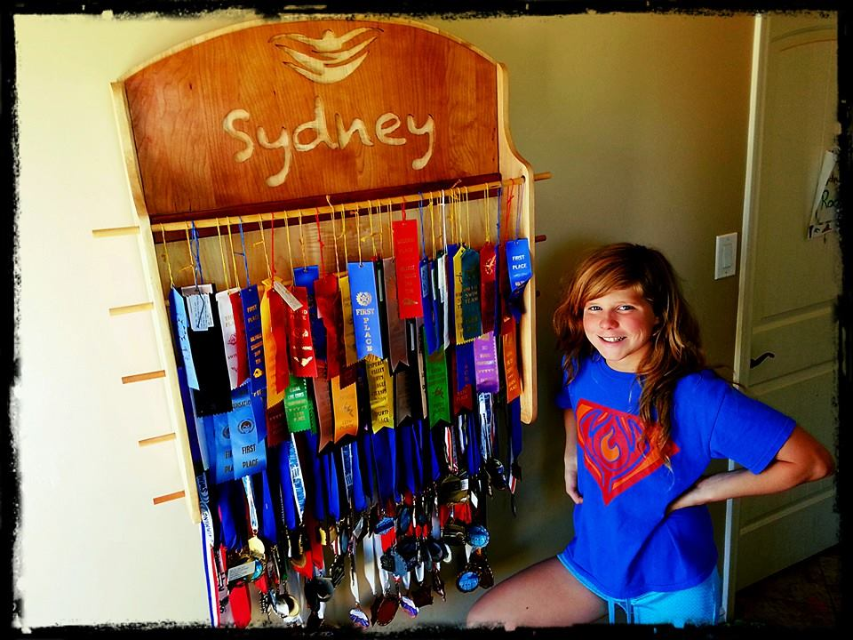 Sydney and her vast medal and ribbon collection