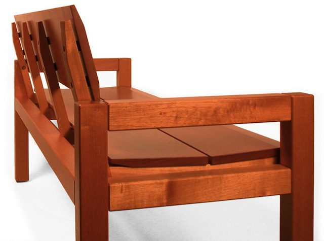 A beautiful Spanish Cedar bench by the Museum and Library Furniture company