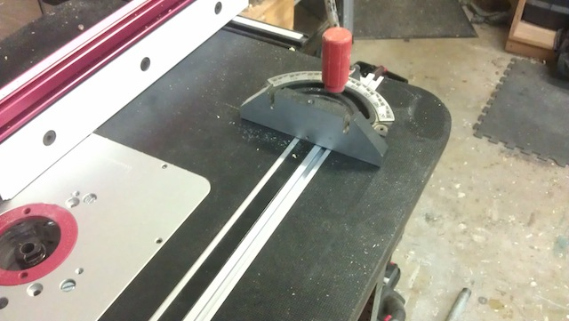 This could work.. a miter gauge