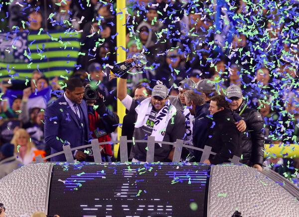 Hoisting the Vince Lombardi trophy