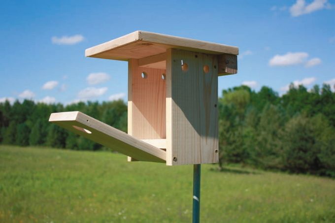 A snazzy looking useful birdhouse