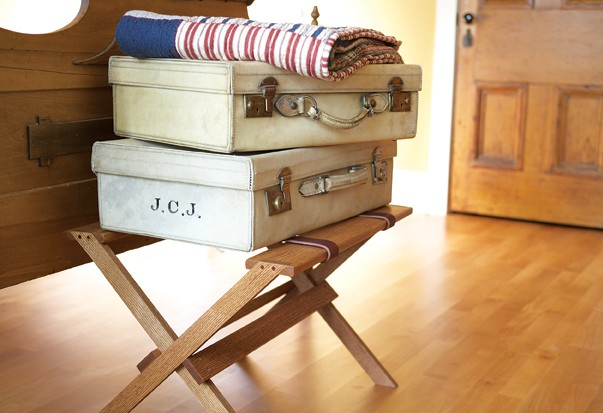 A sweet looking suitcase stand